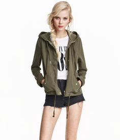 Short parka in soft lyocell fabric. Drawstring hood, concealed zip and snap fasteners at front, and side pockets with flap and snap fastener. Adjustable fastener at cuffs and drawstring at hem. Unlined.