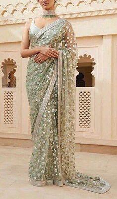 Sage green colour heavy embroidered evening wear indian designer saree/ Indian wedding hand embroidered sari fashion custom made sari#colour #custom #designer #embroidered #evening #fashion #green #hand #heavy #indian #sage #saree #sari #wear #wedding Off White Wedding Dresses, Green Bridesmaid Dresses, Wedding Outfits, Indian Fashion Dresses, Indian Outfits, Indian Clothes, Saris, Saree Designs Party Wear, Indian Bridesmaids