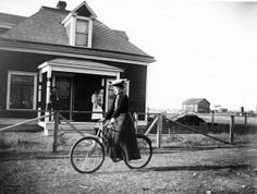 Woman on Bicycle  Inclusive Date(s): 1910