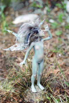 I love these tiny little creatures she creates! Pixie girl Xanti OOAK made by Tatjana Raum, via Etsy.