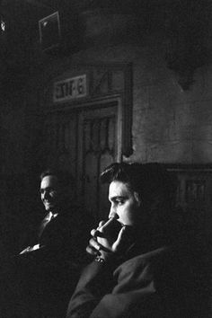 """Elvis Presley photographed by freelance photographer Alfred Wertheimer backstage at CBS-TV studio 50, waiting to perform for the fifth time on the Dorsey Brothers """"Stage Show"""", New York City, Saturday, March 17, 1956."""
