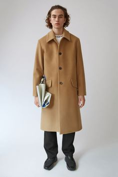 Acne Studios Magma camel is a heritage Loden style coat with extended soft shoulders and tapered sleeves.