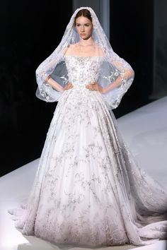 Ivory and pale pink dégradé tulle layered bridal gown with metallic silk thread, pearl pendant and crystal embellishment with matching veil.