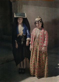 """Iraq: Two young women, noted by Frédéric Gadmer as """"Christians,"""" pose on a Mosul street in Autochrome photography from Archives of the Planet; a project conceived and financed by French banker Albert Kahn in"""