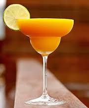 Mango Margarita  1/2 cup Frozen Mango cubes  1/4 cup crushed Ice  2 ounces Tequila  juice of 1/2 Lemon (1-2 tablespoons