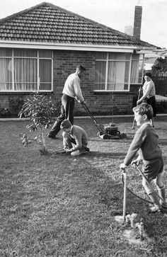 Victoria, Australia 1960s: We had a push mower. The boys look like they have on their School Uniforms. 1963: A typical Melbourne family home in June 1963. Picture: Herald Sun image Library ...