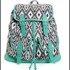"""Black and White Print w Mint Trim Rucksack. NWT. Black and white canvas with mint synthetic leather trim cinch top rucksack backpack. Taffeta lining with magnetic snap closures. Lightly padded adjustable shoulder straps and top handle loop. 14""""H x 15""""W x 6""""D. 60% cotton, 40% polyester. NWT. Inside zippered pocket is big enough for your phone and keys. Bags Backpacks"""