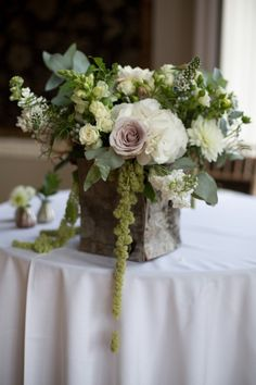 Square vases with small bud vases scattered