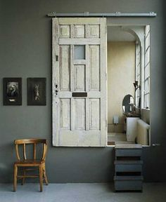 Dishfunctional Designs: New Takes On Old Doors: Salvaged Doors Repurposed Another example of a vintage door on sliders. Salvaged Doors, Old Doors, Windows And Doors, Sliding Doors, Barn Doors, Front Doors, Entry Doors, Repurposed Doors, Screen Doors