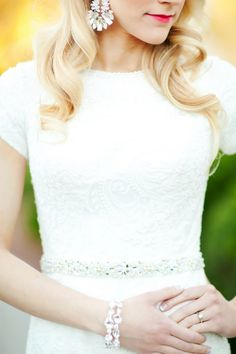 White Lace Wedding Dress with Crystal Accessories | Abbey Kyhl Photography | Modern Glam Wedding Style in Navy and White