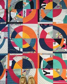 "Slow progress on quilting: A long time ago (well, back in October of 2016), I took a class on improv curves with Cheryl Arkison. I finished my quilt top, which I started calling ""Kelly KAPOWski,"" shortly after. I picked out the backing fabric a long..."