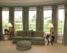 Living room chair setup in front of bay window instead of couch furniture for bay window area for Interior design hendersonville tn