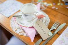 Pretty teacups double up as place names and favours to take away