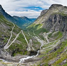Trollstigen (the Troll's Ladder) is a steep (9% grade) mountain road with eleven hairpin turns in Rauma, Norway, part of Norwegian National Road 63 connecting Åndalsnes in Rauma and Valldal in Norddal. Surrounding the road is Reinheimen National Park, Norway's third largest. Trollstigen was opened 1936 by King Haakon VII after 8 years of construction. See impressive Stigfossen waterfall tumble 320 meters as you zig zag up or down this popular, mostly single-lane tourist road.