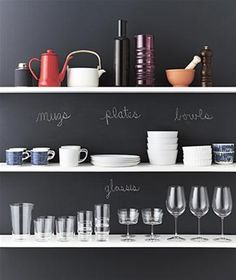 Short on cupboards? Get things out in the open. New York City prop stylist Erin Swift is a fan of displaying everyday dishes against a well-marked chalkboard wall.