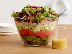 Winter Layered Salad. Brussels sprouts, beets, pomegranate seeds, grapefruit, and barley are some of the delicious ingredients in this wonderful salad.
