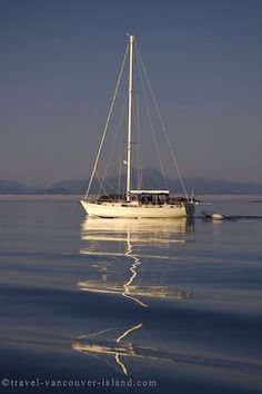 Picture of a sailing boat heading out intoJohnstone Strait during a vacation in BC.