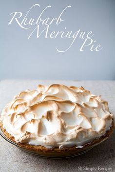 Tart and tangy rhubarb meringue pie! with orange zest, cinnamon, ground ginger, piled high with a light and fluffy meringue. On SimplyRecipes.com