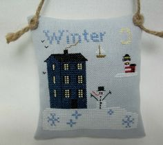 Lighthouse Winter Cross Stitched Ornament / Nautical Hanging Pillow by luvinstitchin4u on Etsy