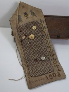 Primitive Cross Stitch 1803 Blue Sewing Roll. $65,00, via Etsy.