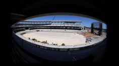 FILE - In this April 30, 2014, file photo, Baylor's new McClane Stadium is shown through a wide-angle lens during construction in Waco, Texas. When school officials met with architects from Populous, they could have asked for anything; they were building from scratch rather than renovating. And what they asked for was a capacity of about 45,000, making McLane Stadium one of the smallest venues in a major conference. (AP Photo/Waco Tribune Herald, Rod Aydelotte)