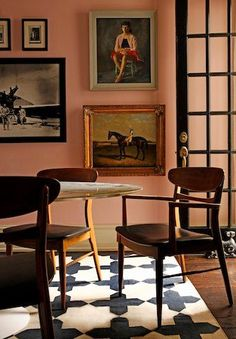 peachy walls/art wall/beautiful chairs and rug