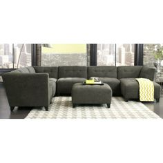 Granite Upholstered Sectional - April, take a look at this and let me know what you think of the design. It comes in a midnight upholstry and I would get just a smaller grouping of the pieces for the game room. Probably a corner, middle then chaise.  We will make a decision on the sofa by the weekend.  It's either this or the one from Ashley.