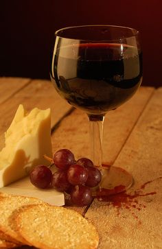 Cheese, crackers, fruit & wine. Reminds me of a good night or a wine tasting event.