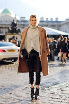 Camille looking cozy in leather and a camel coat in London.