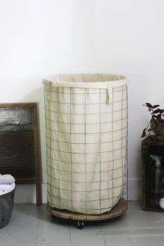 Could also be used as a basket in the living room for blankets / DIY Wire Laundry Hamper @themerrythought