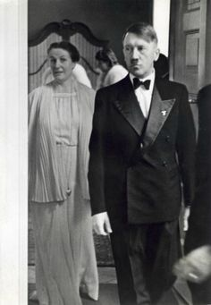 In the early days after Adolf Hitler's appointment as Reichskanzler in 1933 and 1934, he often wore the traditional suit and tie as opposed to a uniform when attending important functions and receptions, with many other leading NS figures doing the same.