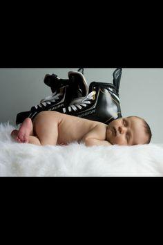 Newborn photo - hockey skates -- Making sure the kid is raised right!