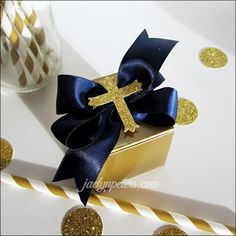 Celebrate his Baptism or First Communion with navy blue and gold favor boxes! Handmade satin bows adorn the top with a gold glitter cross center. A sparkling id