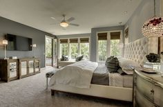 Mirrored Console, fan, windows, door to balcony, headboard, bench stool, .. great feel to this room