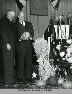 C. Norman Brunsdale and Dwight D. Eisenhower at podium
