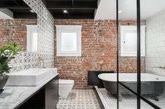 Exposed Brick Wall Modern Bungalow Bathroom Cement Tile Black Tub