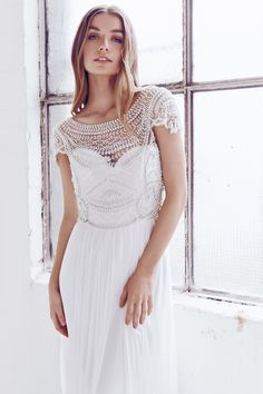Anna Campbell | Florence | shop at Minneapolis & Dallas a&bé bridal shops | With an intricate ivory and pearl-toned embellishment, the Florence features signature Anna Campbell hand-beading, offering additional coverage with a higher illusion neckline and hand-embellished capped sleeves.