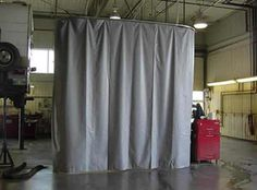 Sound proof curtains as room divider.