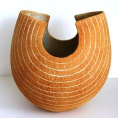 John Ward - The main influences on his work are simple forms of ancient pre-glaze pottery from China and Egypt, early Cypriot pottery and early Persian bowls. More recent influences have been the legendary potters, the late Hans Coper and the late Dame Lucie Rie. The work of Hans Coper for it's formal strength, Lucie Rie for light and colour, and the potter Ian Godfrey for playfulness with form and texture.