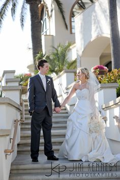 Bride and Groom on stairs outside the Waterfront Beach Resort Hilton in Huntington Beach | Jim Kennedy Photographers