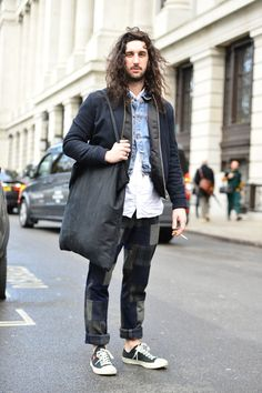 Wearing patchwork trousers with black canvas trainers, white shirt, denim cropped jacket and a black bomber jacket with a black canvas tote #fashion #style #inspiration #mens