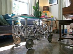 The living room's coffee table is an old coffin trolley