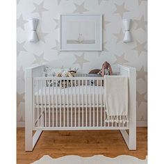 The stars in this modern nursery by @sissyandmarley are so fun! And chic and just yes. Like it to see it win! Picture with the most votes wins  #CopyCatChic