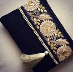 A personal favourite from my Etsy shop https://www.etsy.com/listing/254397331/black-ethnic-clutch-black-jute-handmade