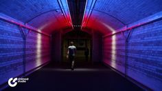 """""""Walk the Light"""" it becomes the visitor who determines that change in the lighting.   Their movement through the Victoria & Albert Museum's Exhibition Road tunnel entrance directly controls this innovative lighting installation.  This experimental interactive lighting design project creates a band of white light that physically follows the visitor, forming a bright line of light tracking"""