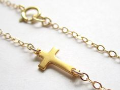 Extra Tiny Gold Sideways Cross Necklace by Keepitclose on Etsy, $27.20
