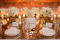 Favourite head table with the bouquets and lots of candles