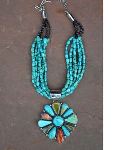 AMAZING turquoise necklace! Has several types of turquoise and spiny oyster. Truly a statement piece!!!