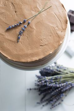 Heaven - Earl Grey Cake with Chocolate Lavender Frosting.  NEED: 1 c (240 mL) whole milk; 1 vanilla bean; 4 bags Earl Grey tea; 3 c  (360 grams) all-purpose flour; 2½ tsp baking powder; 1 tsp finely ground Earl Grey tea leaves; ½ tsp salt; 1 c (225 grams) unsalted butter, at room temperature; 2 c (400 grams) granulated sugar; 4 lg eggs, at room temperature; ¼ tsp Bergamot extract (optional);