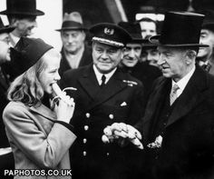 12-year-old Daphne Philips gleefully eats the first banana to arrive in Britain after the war, given to her by Alderman James Owen JP, Lord Mayor of Bristol, on the quay-side at Portsmouth, Hampshire.
